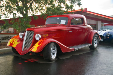 Wall Mural - A 30s Ford hotrod with flames captured at a car show in the rain