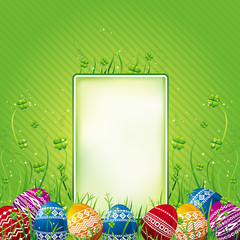 many color easter eggs over green  background