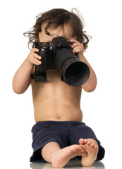 Baby with camera, isolated on a white background.