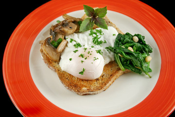 Deurstickers Gebakken Eieren Poached egg breakfast with blanched spinach and pine nuts