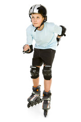 Young skater boy ready to ride on roller skates