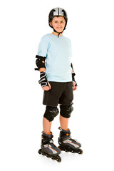 Young, happy roller boy in protection kit standing and looking