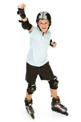 Young, happy roller boy in protection kit standing with hand up