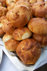 Rolls from fancy pastry combined by mountain on a tray