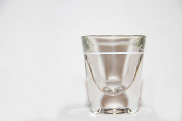 Shot Glass with white backround and slight reflection at base