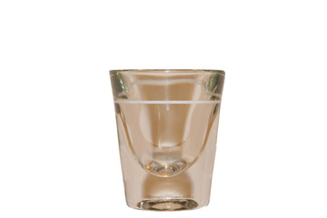 Clear shot glass isolated on a white background
