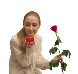 beauty Girl with gifts and red rose on white. Isolated
