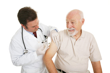 Senior man getting a flu shot from his doctor.  Isolated