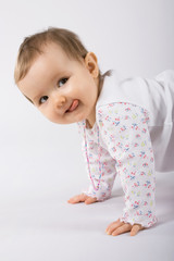 One year old cute caucasian baby girl making faces.