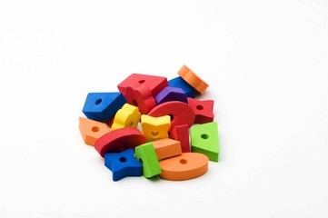 multicolored toys . Different shapes.