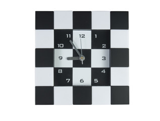 checker cross pattern clock design with white background