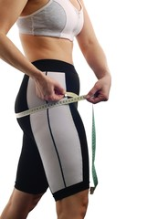 Measuring waist - womans body in sportswear