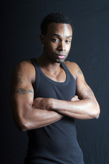 Strong Black man with arms crossed