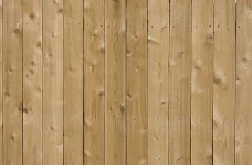 new cedar wood fence background in sunlight