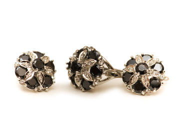 Earrings with black and silver stones isolated on white