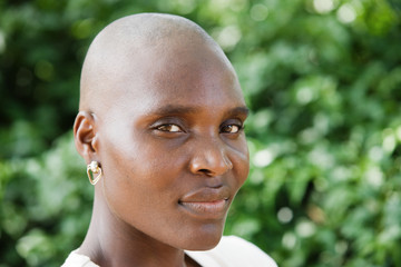 Bald and beautiful typical African woman.