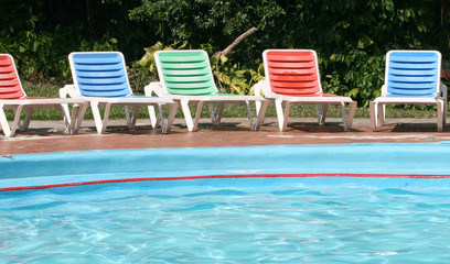 Colorful chairs around the pool