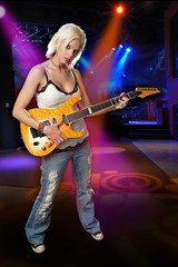 Blond punk musician on holding a guitar on stage