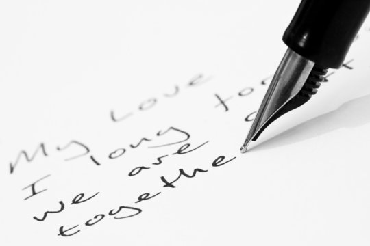 A fountain pen writing a love letter by hand
