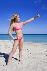 Beautiful Caucasian female teenage standing on the beach