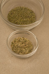 Fennel and rosemary in seperate spice bowls
