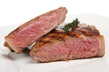 Rare sirloin steak garnished with thyme