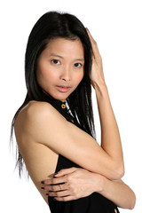 attractive slim Asian woman framing her face with her arms