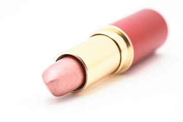 Pink lipstick with red tube