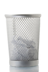 Mesh trash bin with some paper inside