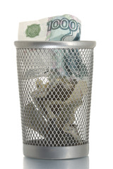 Mesh trash bin with thousand roubles inside