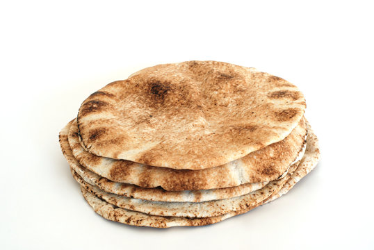 Pita flat bread isolated on white