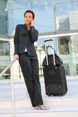 A pretty african american business woman travelling