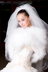 bride in a fur cape