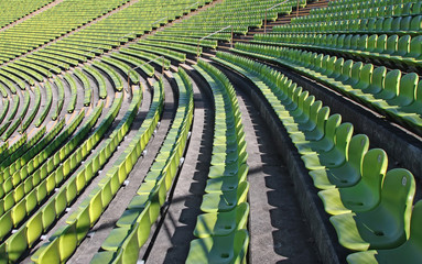 A photography of green chairs in the olympic station in munich