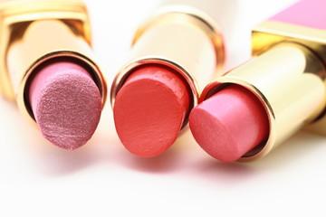 Three reddish lipsticks