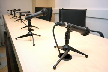 Press Conference, conference room with microphones in row