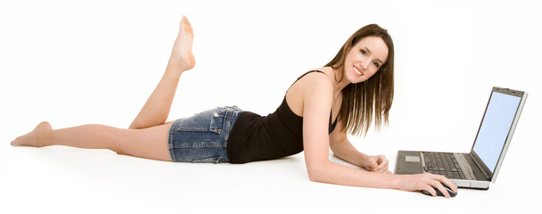 Young Smiling Woman on Floor Using Laptop