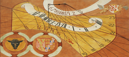 Close-up of old painted sun clock from year 1729