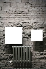 two blank frames on grey brick wall