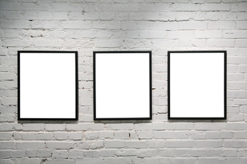 black frames on white brick wall 3
