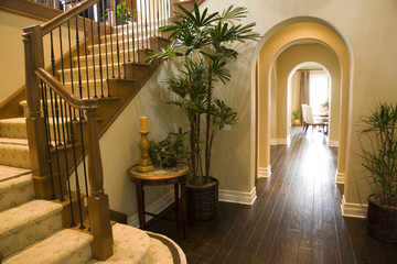 Luxury home hallway with a hardwood floor.