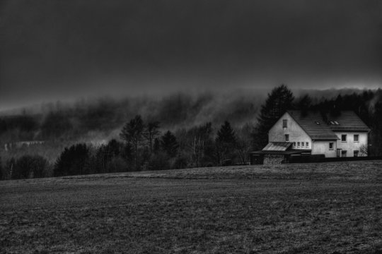 Foggy landscape with house on it