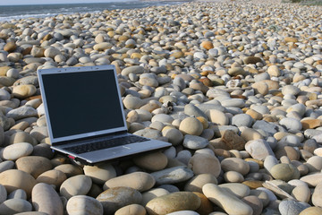 Personal Computer Isolated at the beach
