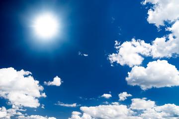Dramatic high contrast blue sky with sun