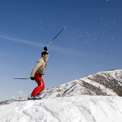 Snow Skier jumping over blue sky