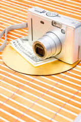 Us money and digital photo camera