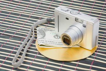 Us money and digital photo camera