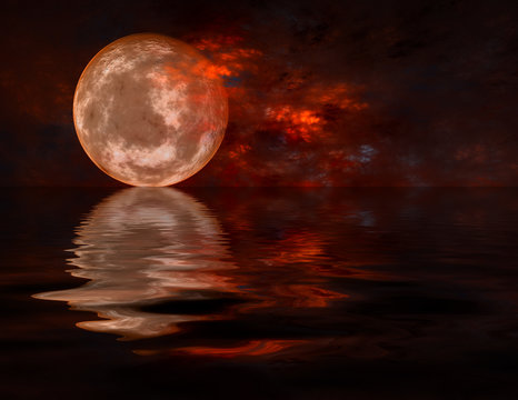 Full moon raising over water
