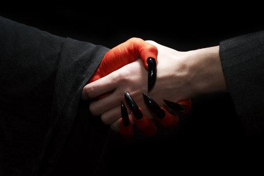Handshake with Devil