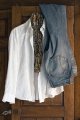 white cotton blouse, scarfe and jeans on antique cabinet